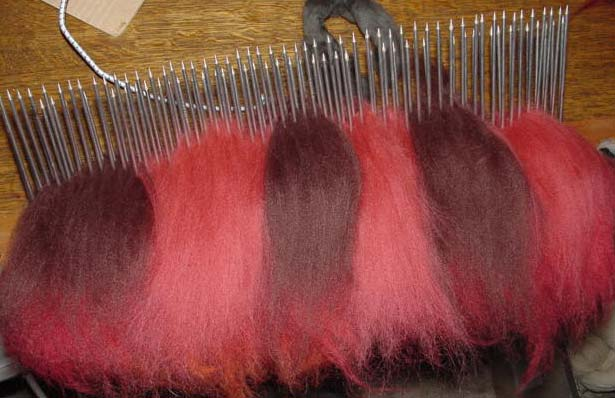 Wool fibre on a hackle for colour blending