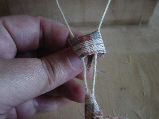 How to make a ghiordes knot step 2