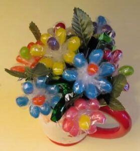 Jelly bean flowers in a santa claus mug