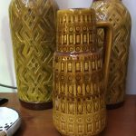 Brown ceramic jugs with textured design