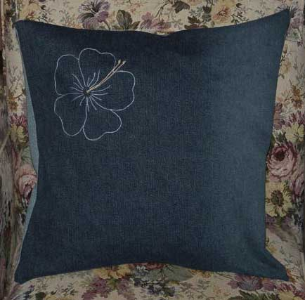 Denim cushion cover with an embroidered flower