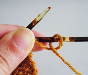 Working a yarn over at the beginning of a row before a purl stitch. Diagram 1.