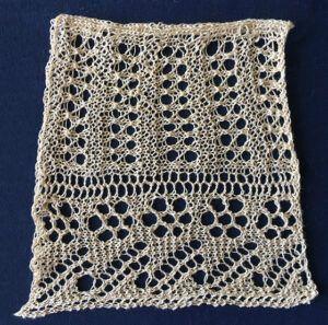Lace knit collar with large eyelet daisies and eyelet ribbing.