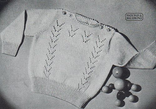 Free knitting pattern for a baby jumper/sweater with flying geese lace patterning