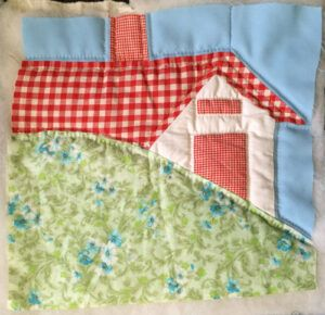 Quilt as you go house block with red gingham roof