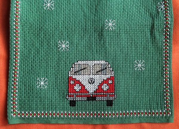 Cross stitch Christmas table runner with VW vans and snowflakes on vintage binca fabric.