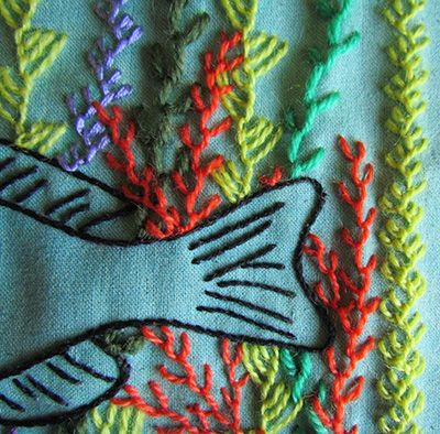 Feather stitch seaweed around a fish's tail