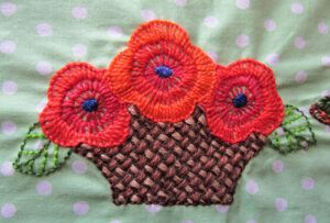 Embroidered flowers with blanket stitch shading