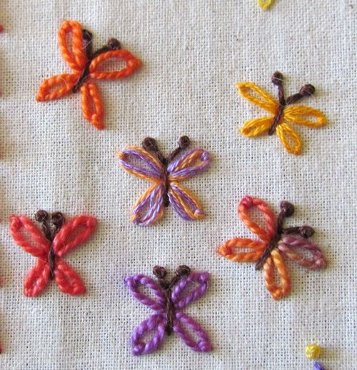 Butterflies worked in detached chain stitch