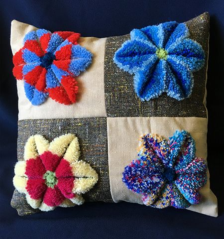 Plushwork embroidered cushion