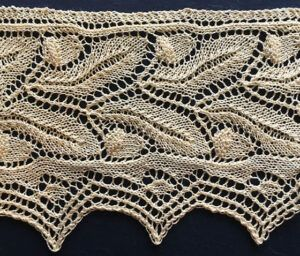 Victorian style knitted lace edging with two rows of acorns ad oak leaves