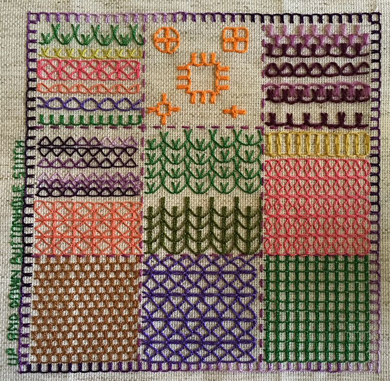 Embroidered sampler with up and down buttonhole stitch fillings.