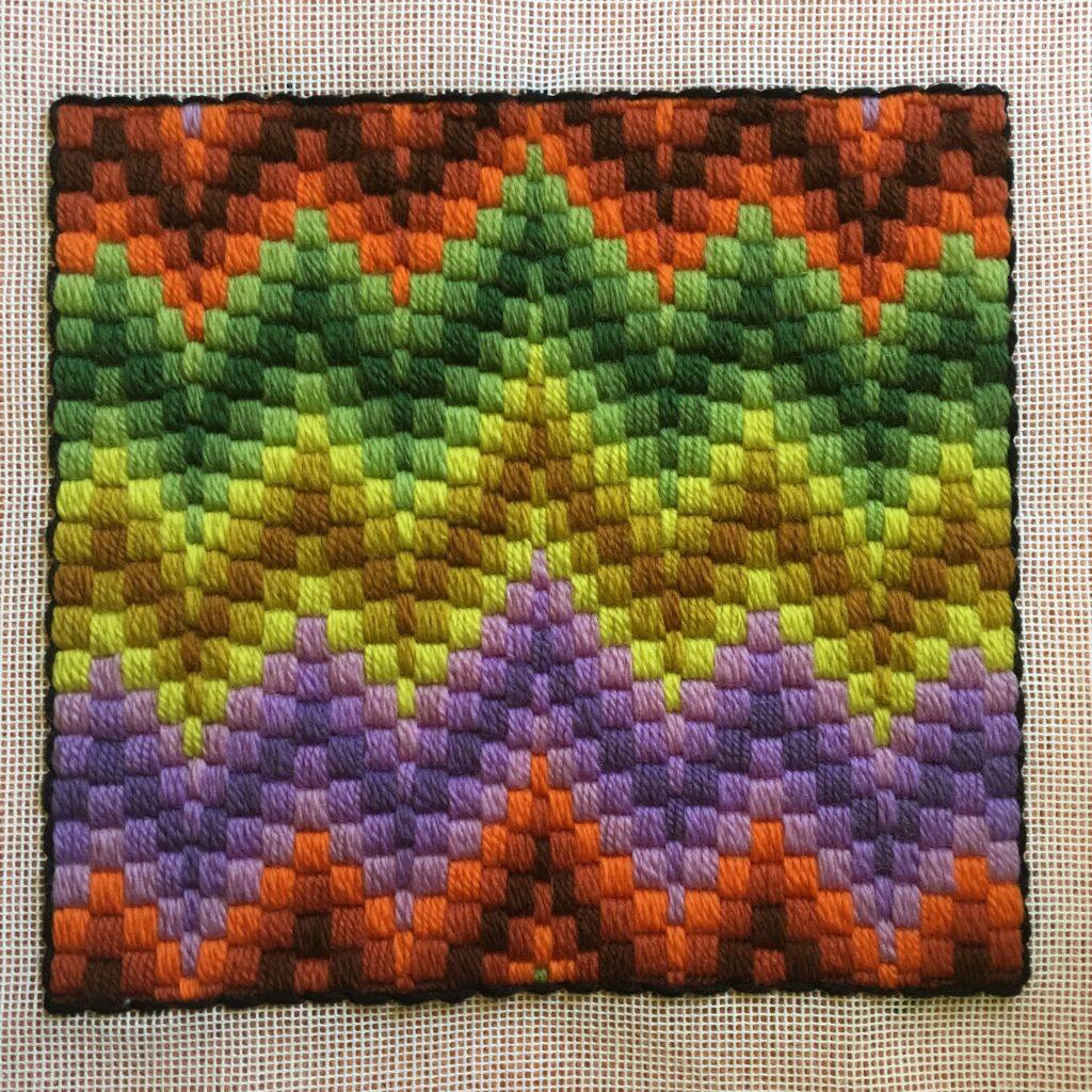 Satin stitch worked on canvas.