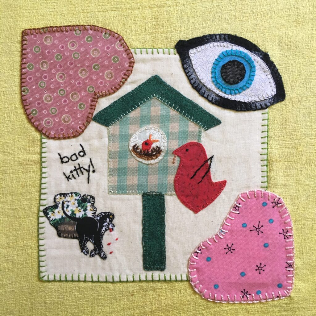 Applique sampler with found fabrics