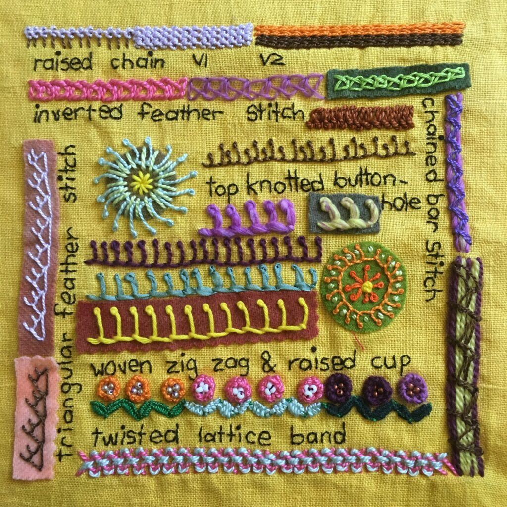 Embroidered sampler with a range of stitches on yellow fabric.