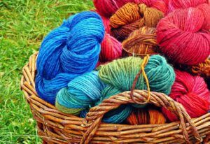 Balls of brightly coloured yarn in a basket