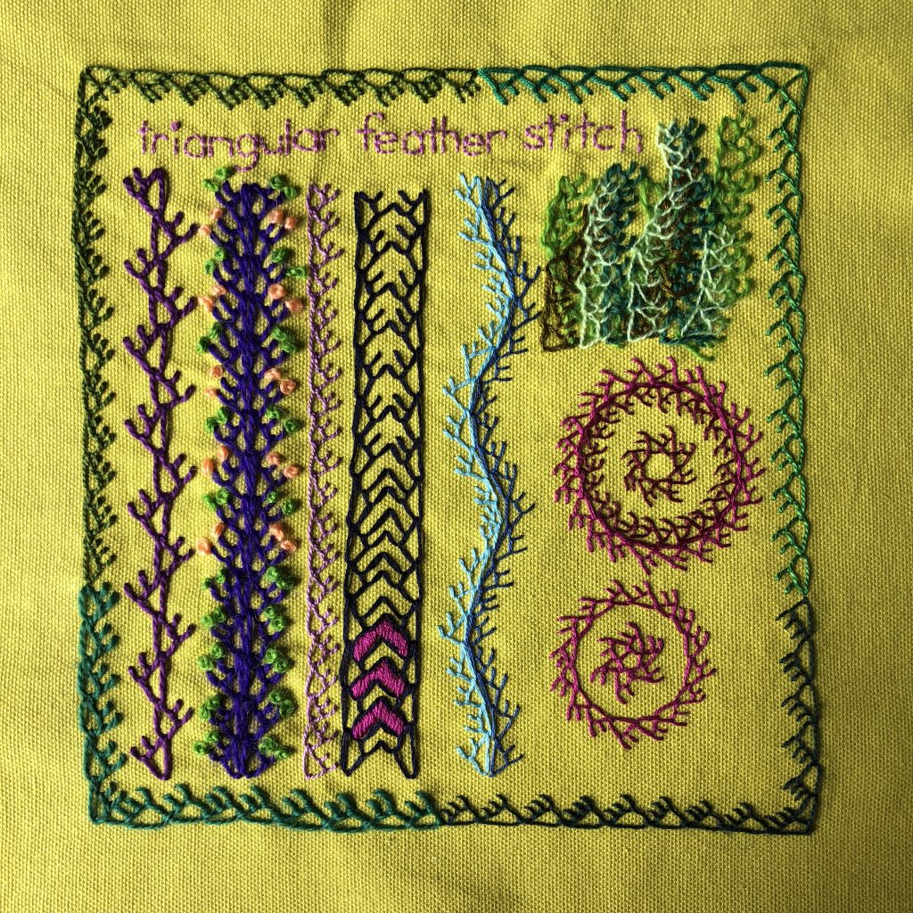 Triangular feather stitch embroidery sampler showing borders and layering.