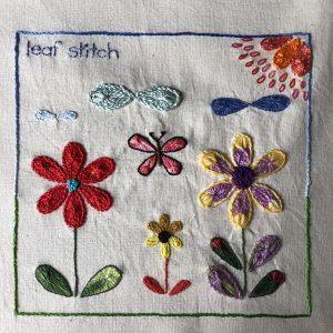 Floral sampler worked in leaf stitch.