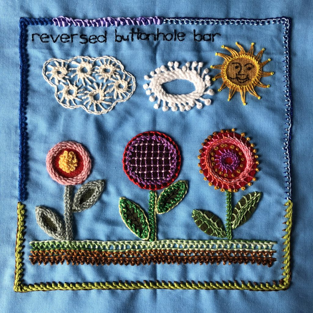 Garden scene embroidery sampler worked in reversed buttonhole bar stitch.