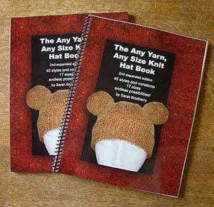 Two printed copies of the Any Yarn, Any Size Knit Hat Book