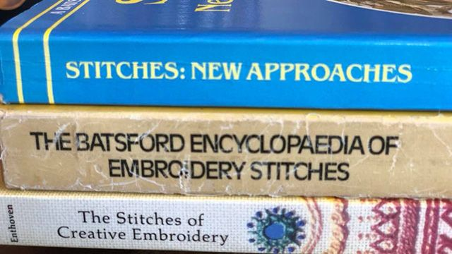 Three vintage embroidery books.