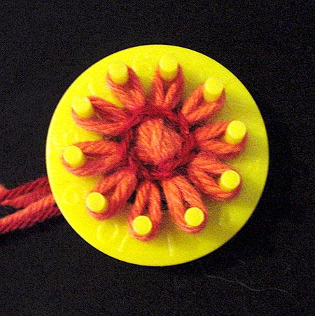 Winding a flower on a loom
