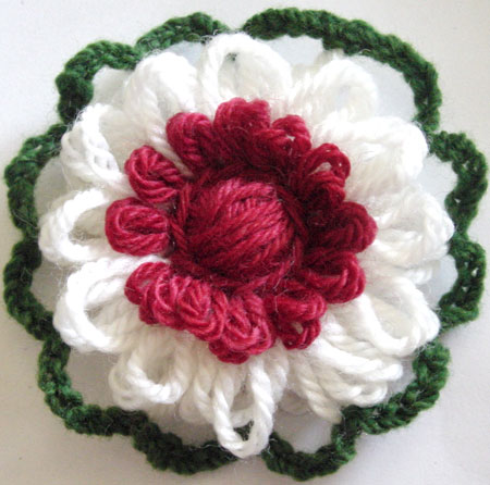 Finished reversible loomed flower