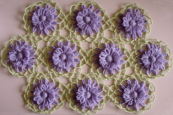 Loomed flowers joined together with crochet