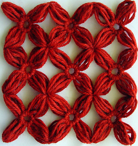 Nine yarn flowers joined together
