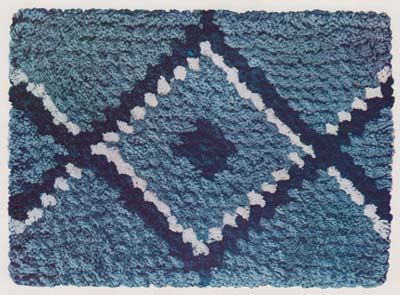 Diamond patterned rug in blue