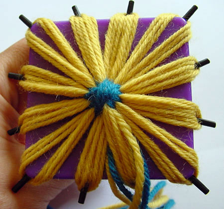 A finished flower still on the daisy winder