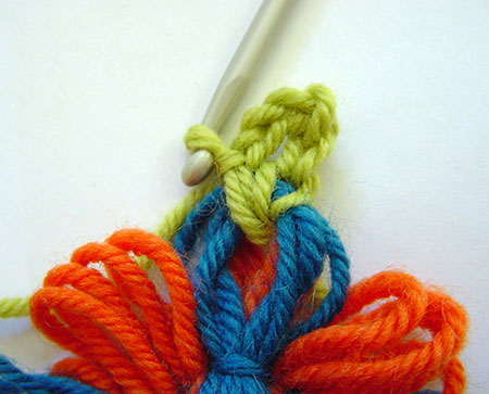 Working the crochet edging on a two colour loomed flower