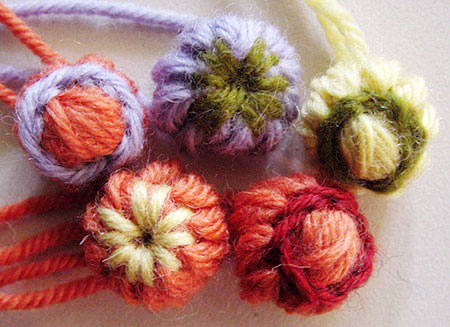 A collection of loomed flower buds