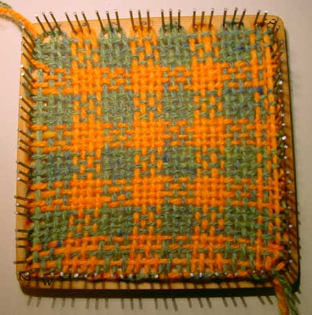 The finished weaving on the weavette loom