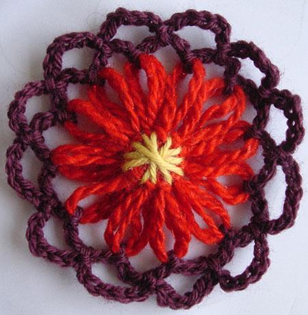 Yarn flower with a star stitch center