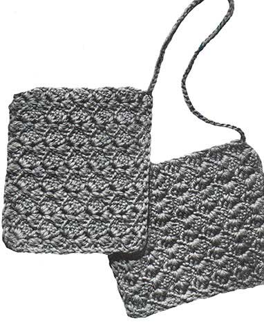 Two shell stitch potholders joined by a chain for picking up large cooking pans