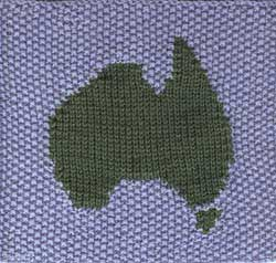 Hand knit afghan stitch with intarsia Australian map and seed stitch background.