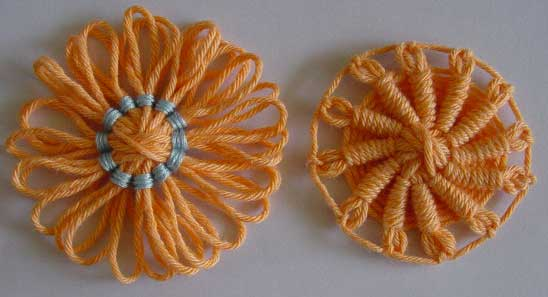 Yarn flowers with back stitch centers