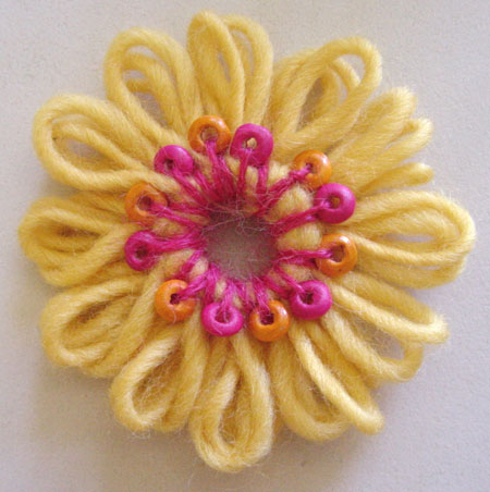 Making a beaded flower on a flower loom