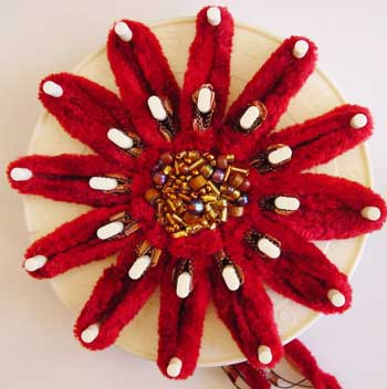 The finished flower on the loom