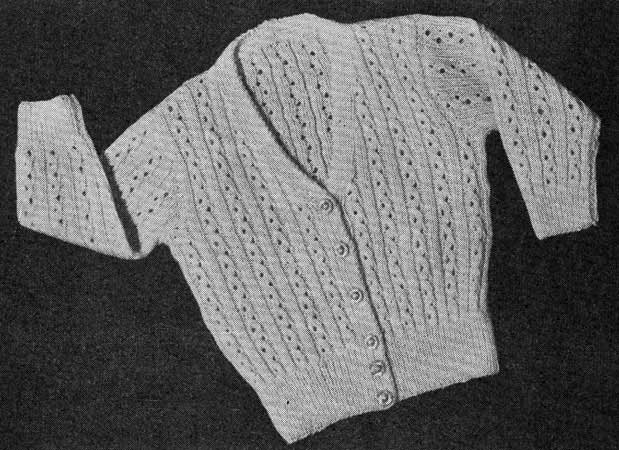 Long sleeved v-nack baby cardigan with vertical lace stripes