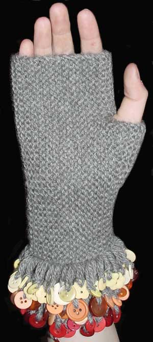 Garter sttich fingerless mitts with buttoned fringe