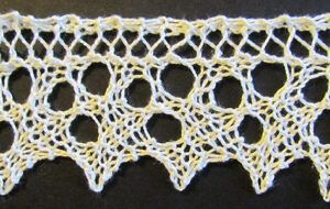 Triple eyelet lace edging knit from a Victorian era knitting pattern.