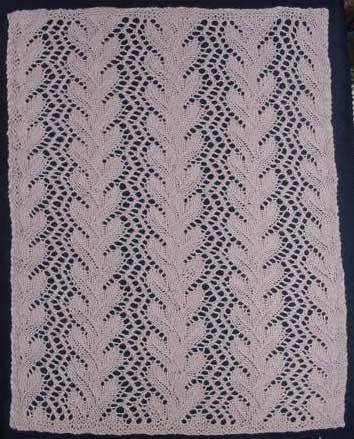 Rectangular knitted doily with coral lace patterning