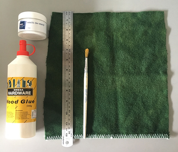 Glue, coloured wool blanket, ruler, paint and paint brush