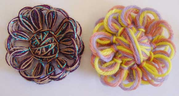Two crazy daisies made of fine and medium wieght yarns