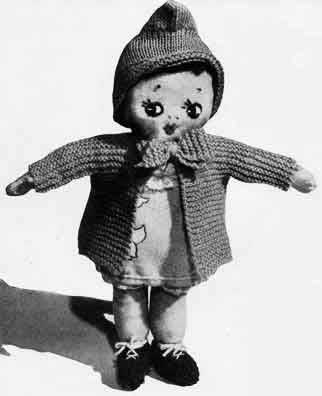 Rag doll with knitted coat and bonnet