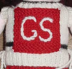 Knitted netball bib for dolls