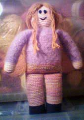 Knitted doll with lavender mohair shirt and pink variegated pants