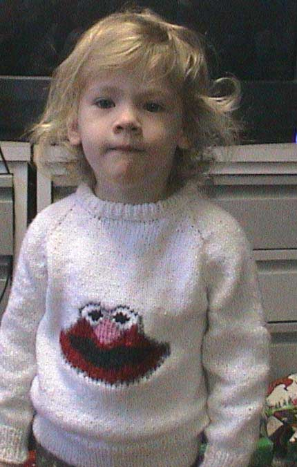 White sweater with Elmo on the front